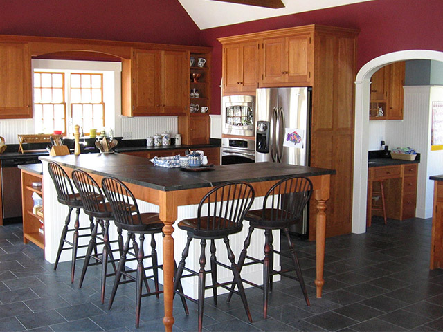 A Vermont Soapstone floor is light blue-gray with subtle veining, which compliments the oiled soapstone countertops.