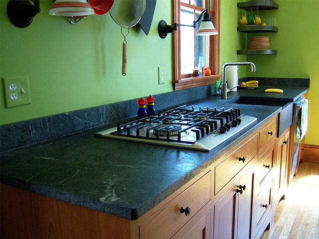 Vermont Soapstone kitchen countertop with built-in cooktop and apron-front sink