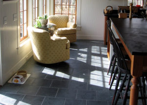 Vermont Soapstone was used to coordinate the table top and the floor.