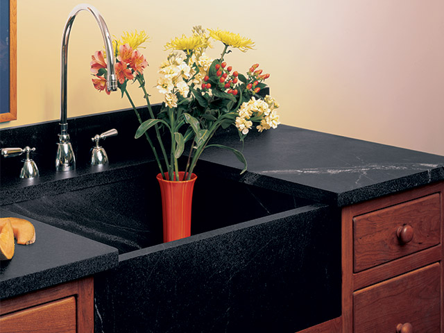 A Vermont Soapstone oiled sink is nearly black with the light veins in high contrast.
