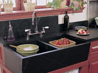 Rinsing strawberries in a Vermont Soapstone Windsor double sink