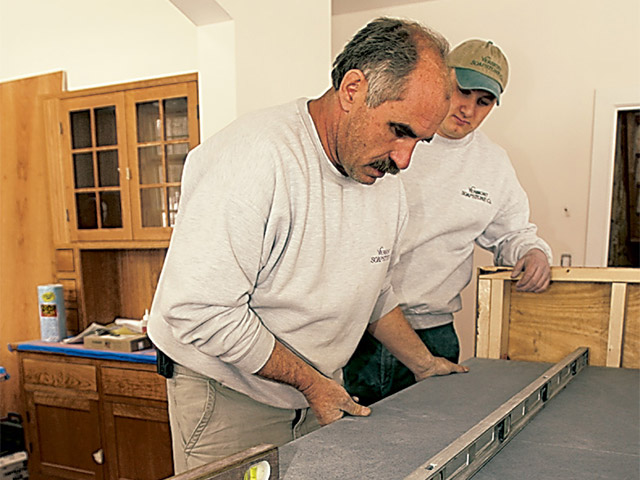 Vermont Soapstone's experienced installation teams custom cut right at your location to ensure a perfect fit.