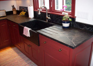 The countertop and splash guards were custom built to fit the customer's over-sized cupboards. Note the drain vents cut on the countertop to drain water into the deep Windsor Sink.