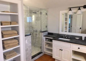 Vermont Soapstone accents on the shower surround tie-in nicely with the double vanity.