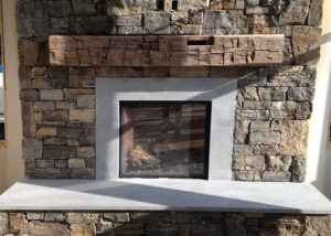 Vermont Soapstone provided the custom cut stone for this fireplace insert and hearth.